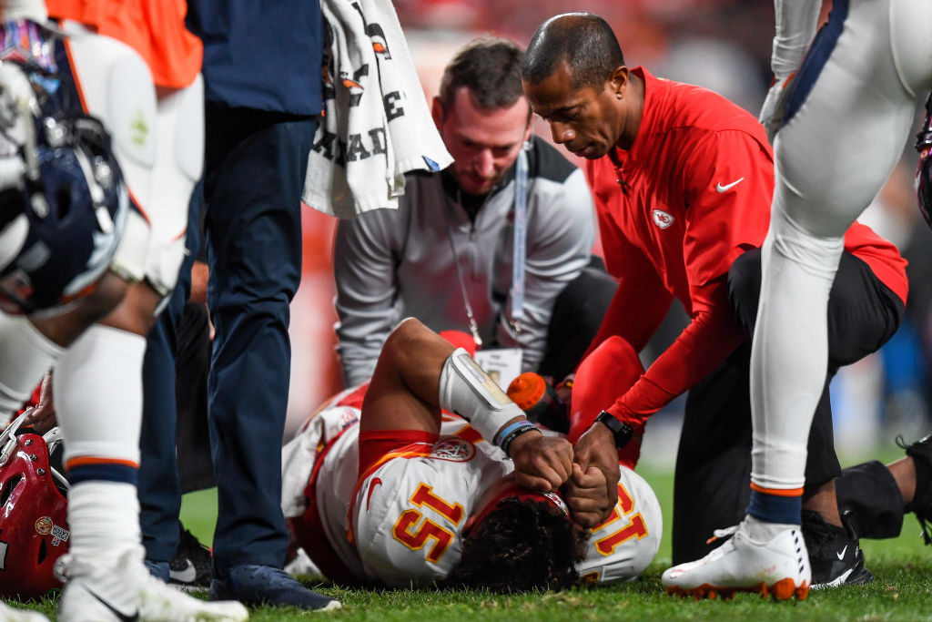 Patrick Mahomes of the Kansas City Chiefs is tended to by trainers after sustaining an injury