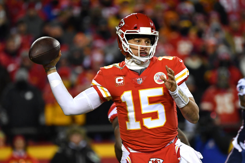 Patrick Mahomes looking downfield about to throw the football.