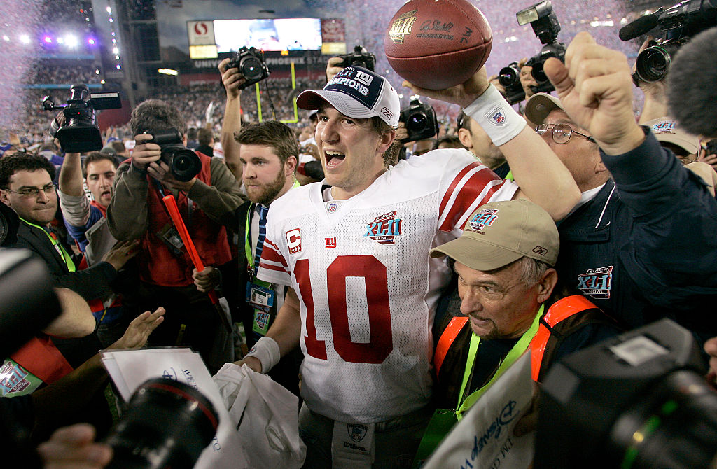 Giants quarterback Eli Manning celebrates after the Giants win Super Bowl XLII
