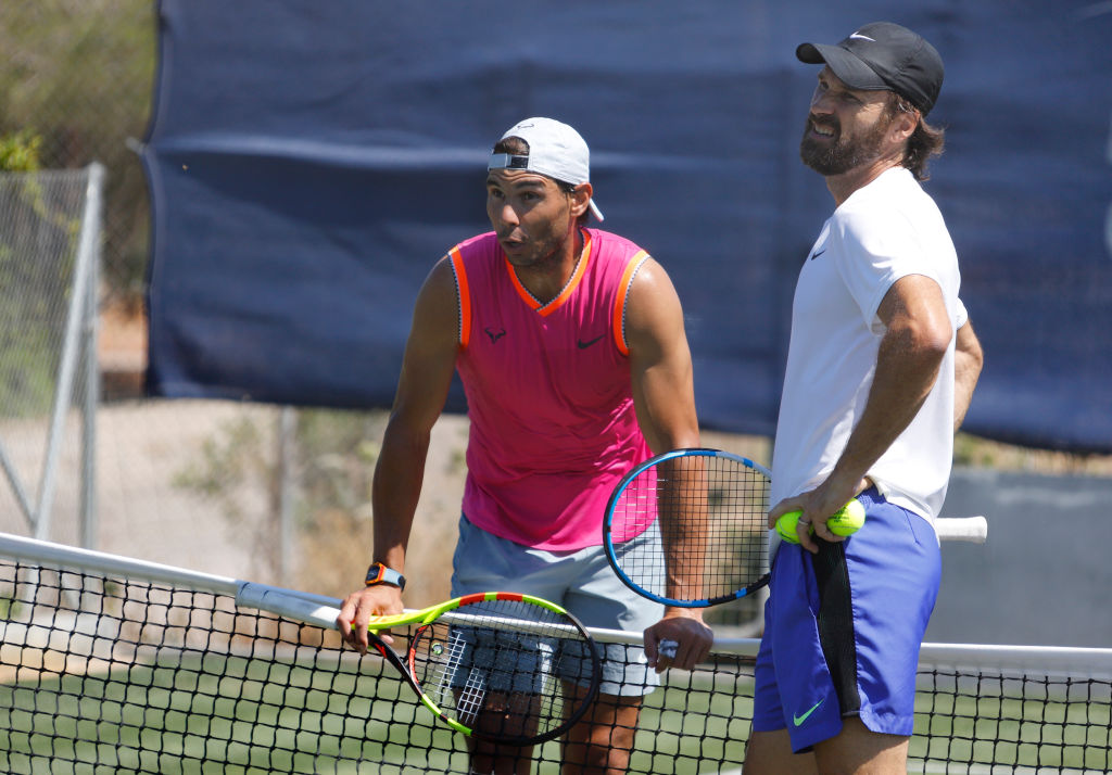 Rafael Nadal training with his coach Carlos Moya