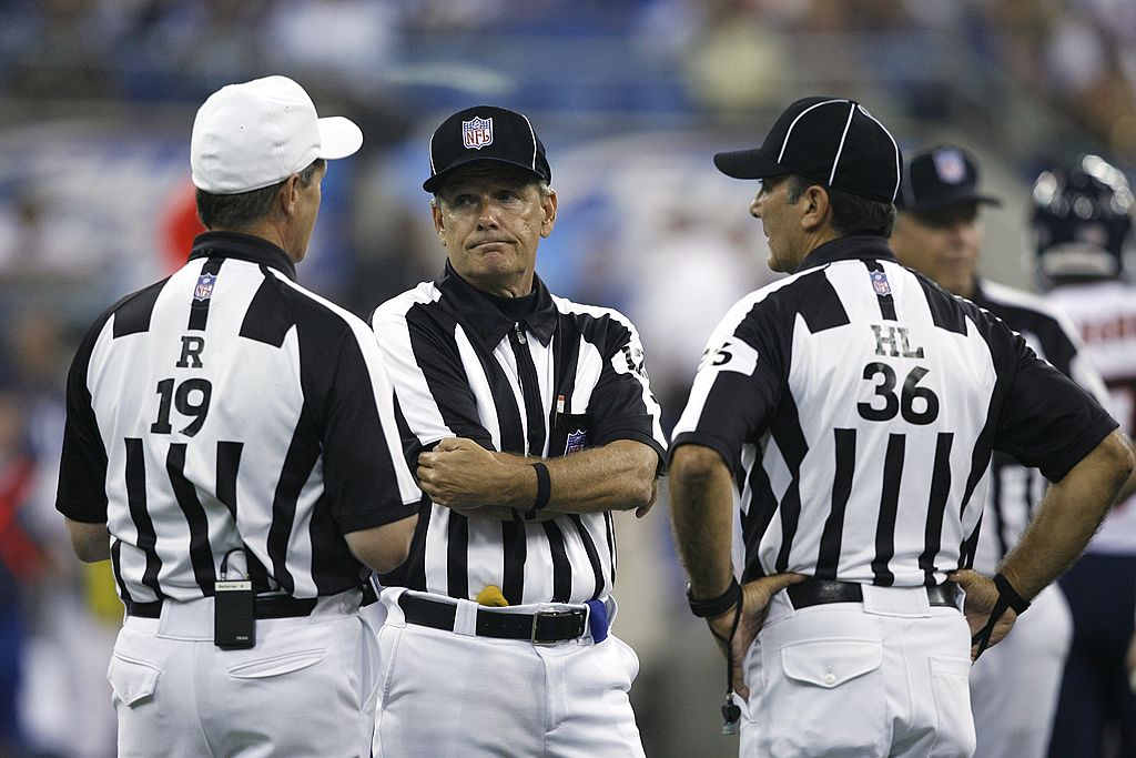 Referee Larry Rose helps Bruce Arians understand pass interference and other penalties.
