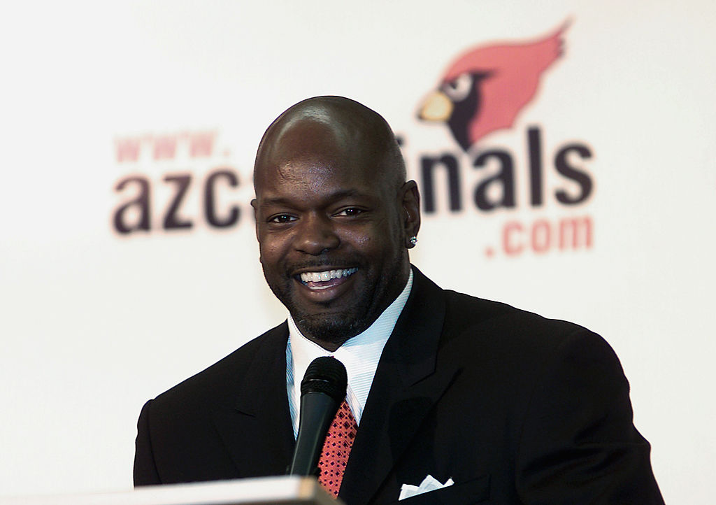 The NFL's all-time leading rusher, running back Emmitt Smith, speaks to the media