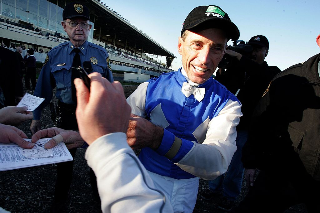 Jockey Russell Baze greets fans after winning his 9,531st race