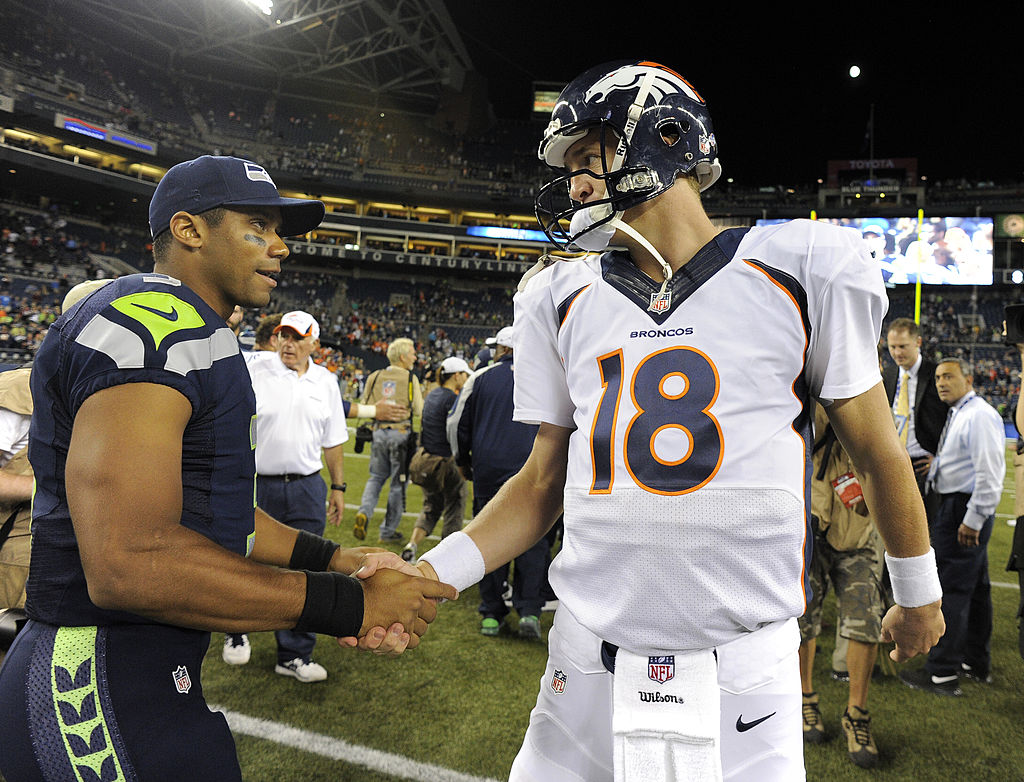 Seahawks Russell Wilson and former Broncos quarterback Peyton Manning