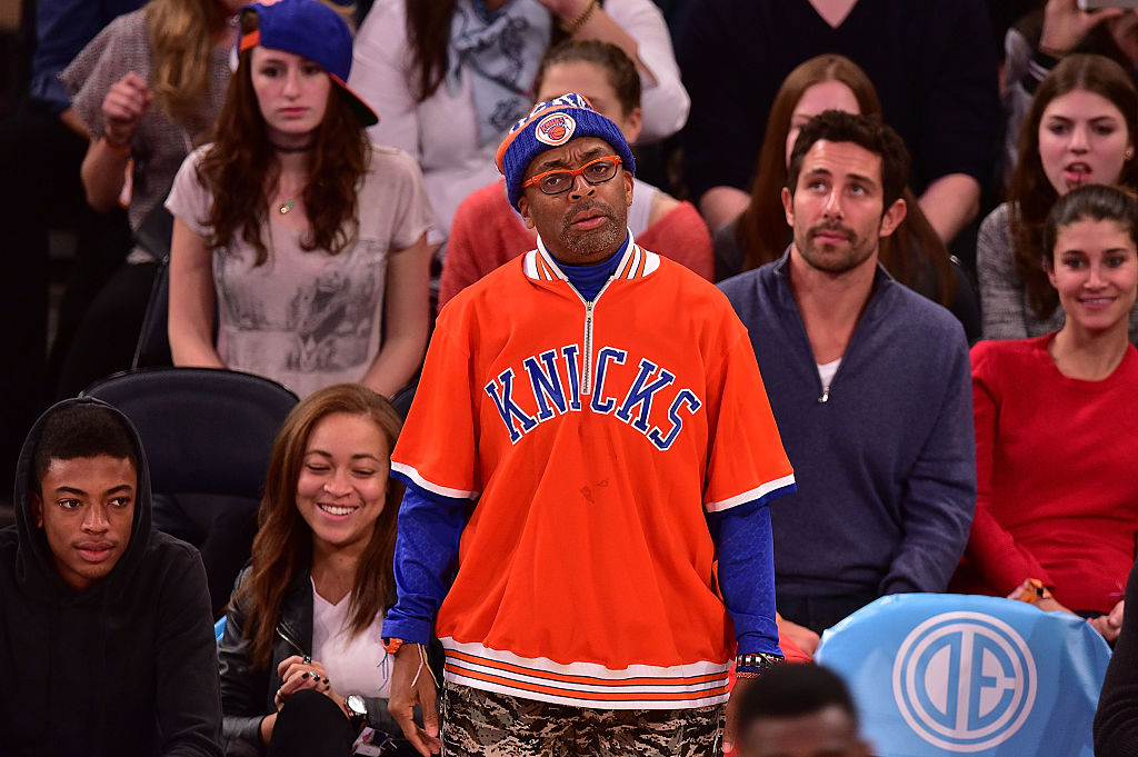 NBA fan Spike Lee cheers on the New York Knicks at Madison Square Garden.