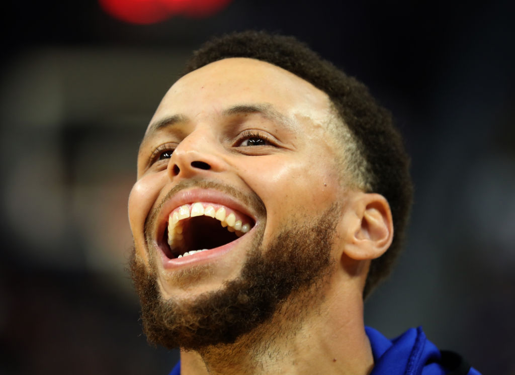 Golden State Warriors' guard Stephen Curry smiling.