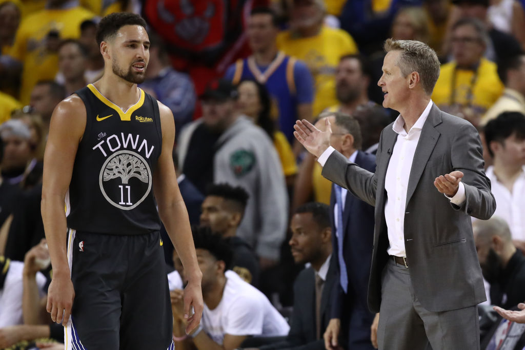 Warriors guard Klay Thompson and head coach Steve Kerr