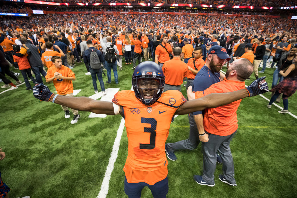 A Syracuse football player celebrates in the Carrier Dome after a win.