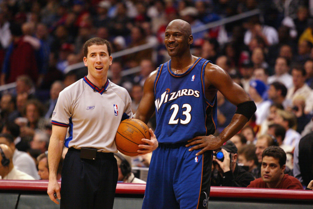 NBA referee Tim Donaghy chats with Michael Jordan during a game.