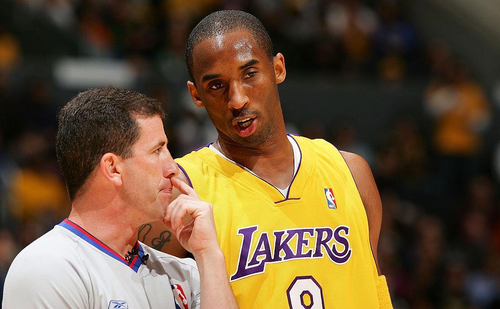 NBA referee Tim Donaghy talks to Kobe Bryant on the court.