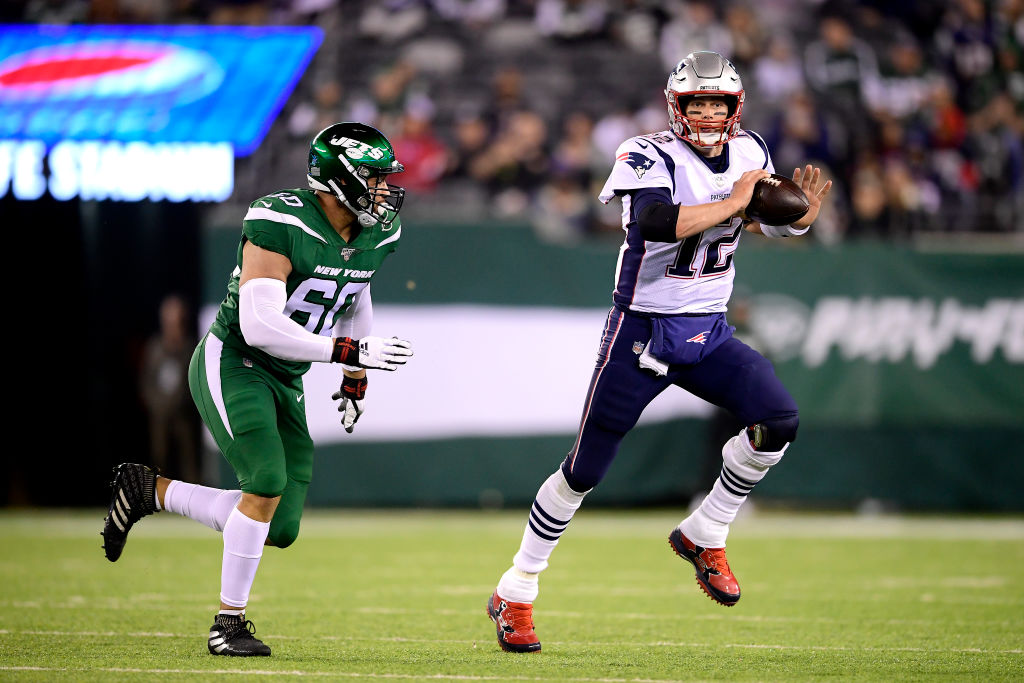 New England Patriots quarterback Tom Brady passes against the New York Jets.