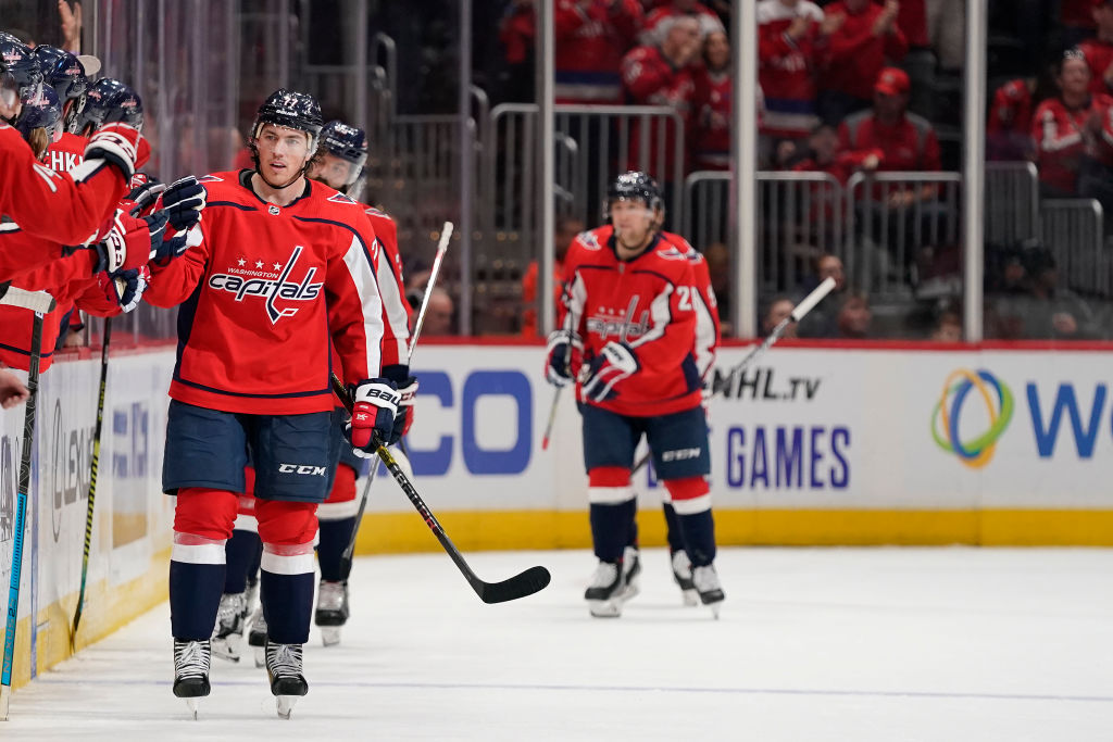The Washington Capitals exchange high-fives with the bench.