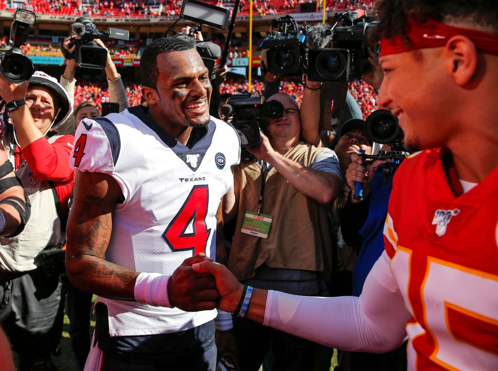 NFL MVP candidates Deshaun Watson and Patrick Mahomes shake hands at mid-field