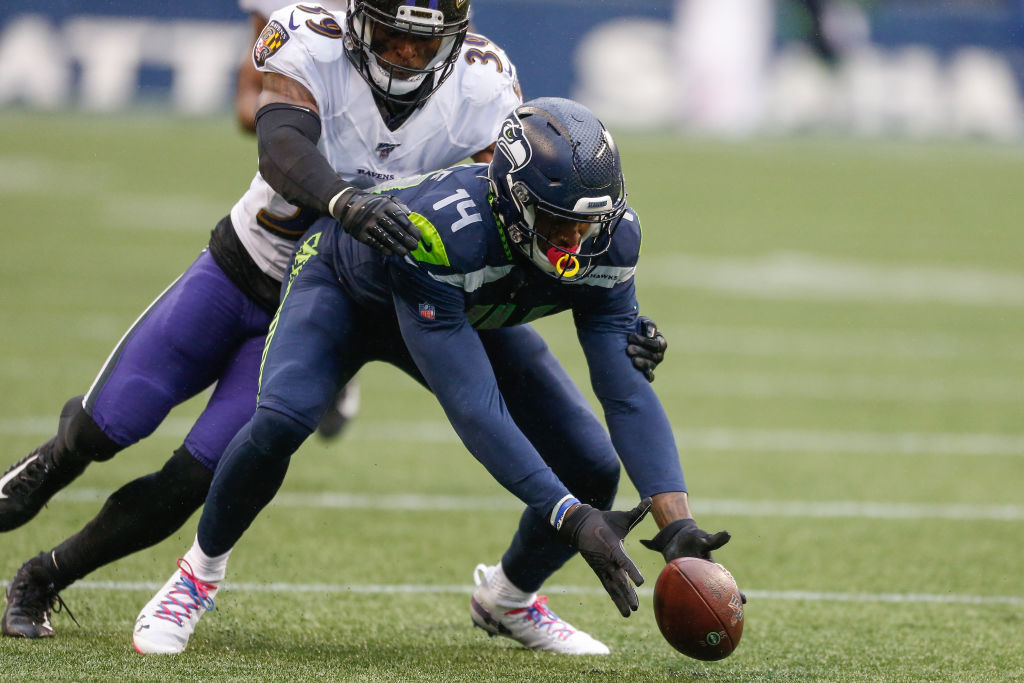 Wide receiver DK Metcalf of the Seattle Seahawks fumbles