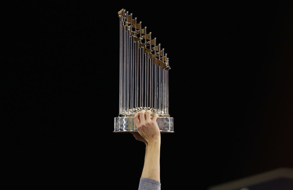 A member of the Houston Astros holds the Commissioner's Trophy