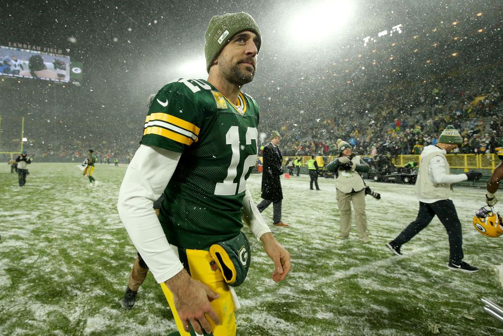 Aaron Rodgers of the Green Bay Packers looks on after defeating the Carolina Panthers in the snow