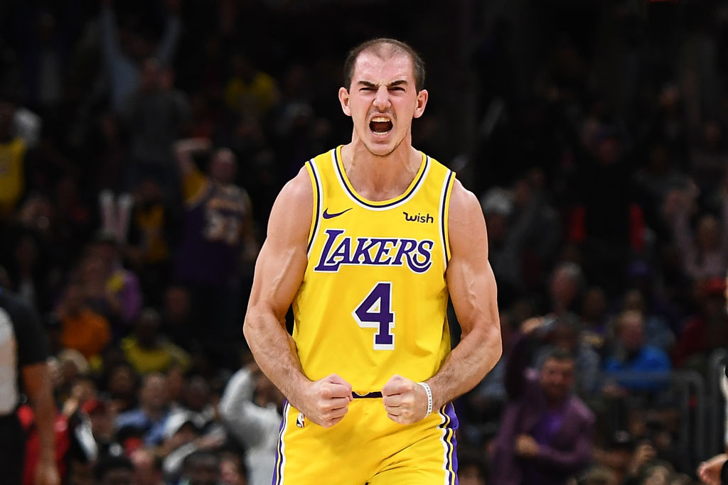 NBA player, Alex Caruso, celebrates after scoring a basket.