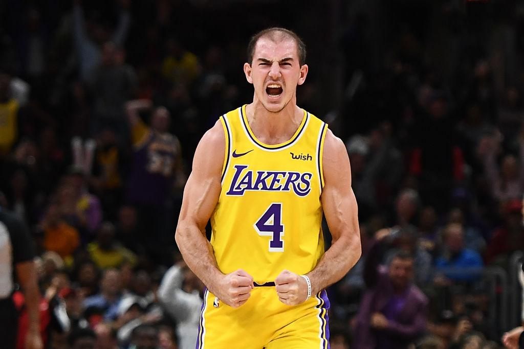 NBA player, Alex Caruso, celebrates after scoring a basket.