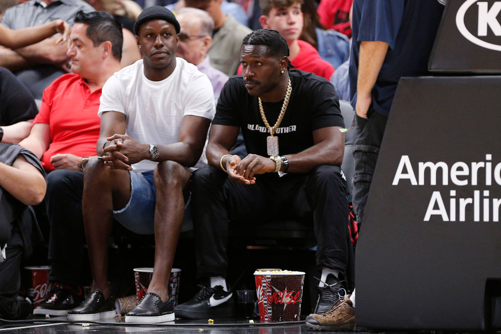 Antonio Brown takes in a Miami Heat game at courtside