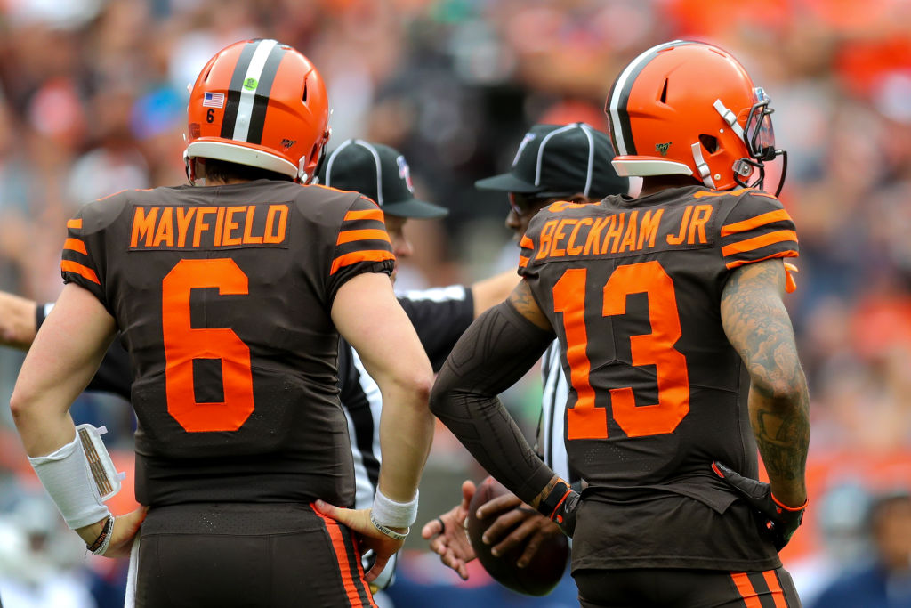 Cleveland Browns' stars Baker Mayfield and Odell Beckham standing on the sideline.