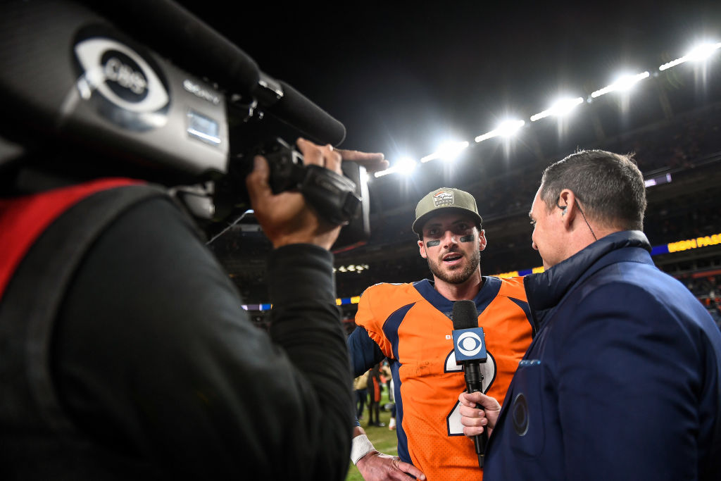 Brandon Allen of the Denver Broncos gives an interview on the field