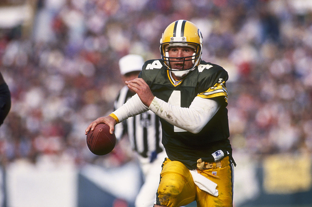 Packers quarterback, Brett Farve, eludes pressure from the defense.