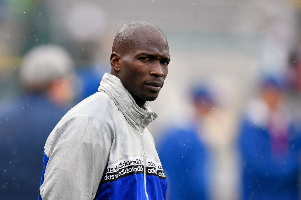Chad Ochocinco former NFL player looking on.