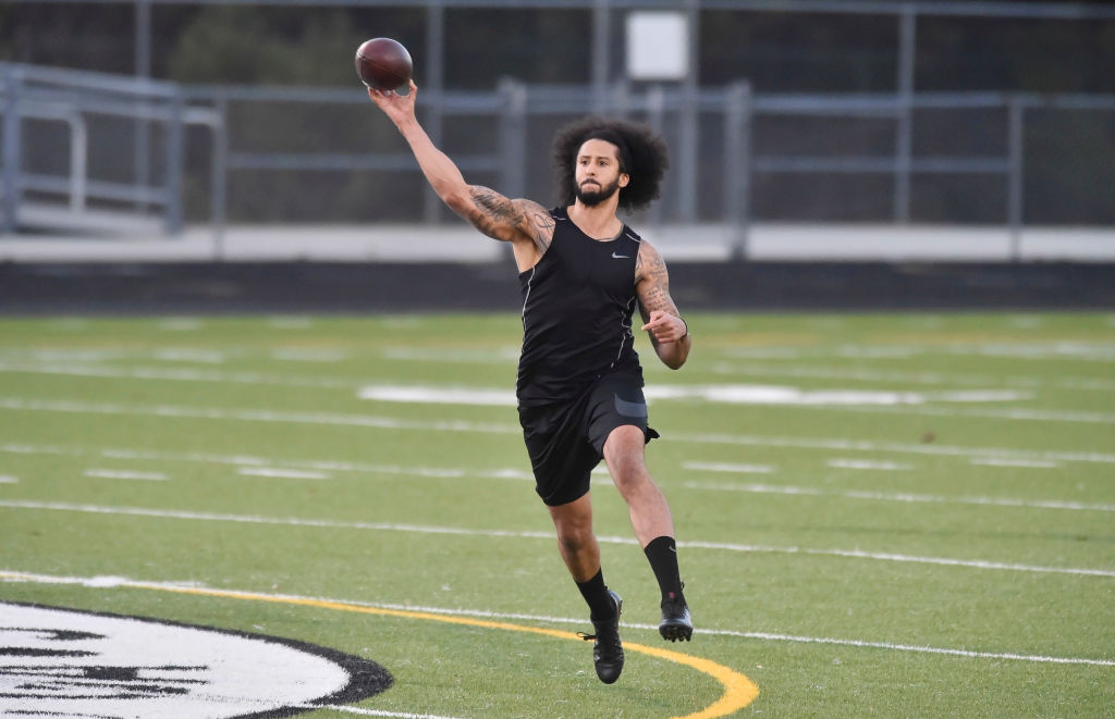 Colin Kaepernick does a passing drill in front of NFL scouts.