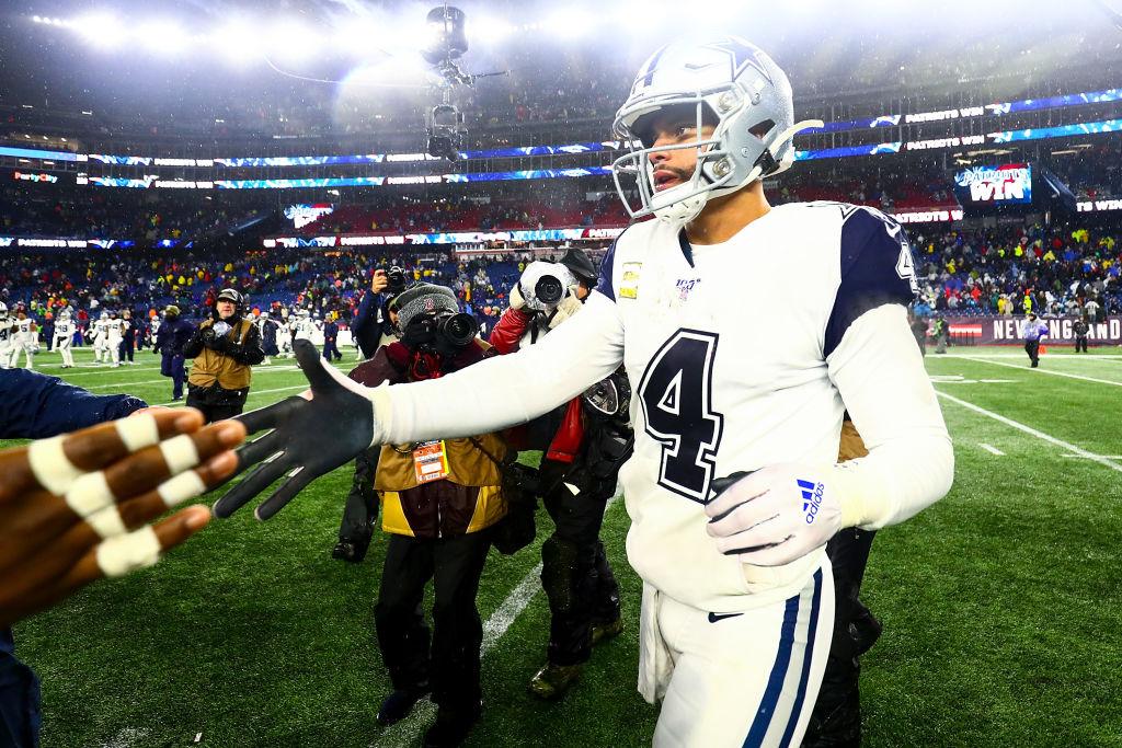 Dak Prescott of the Dallas Cowboys exits the field after a loss