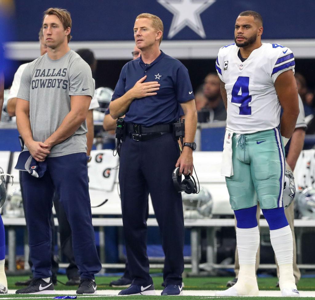 Dallas Cowboys linebacker Sean Lee, Jason Garrett and Dak Prescott stand during the national anthem
