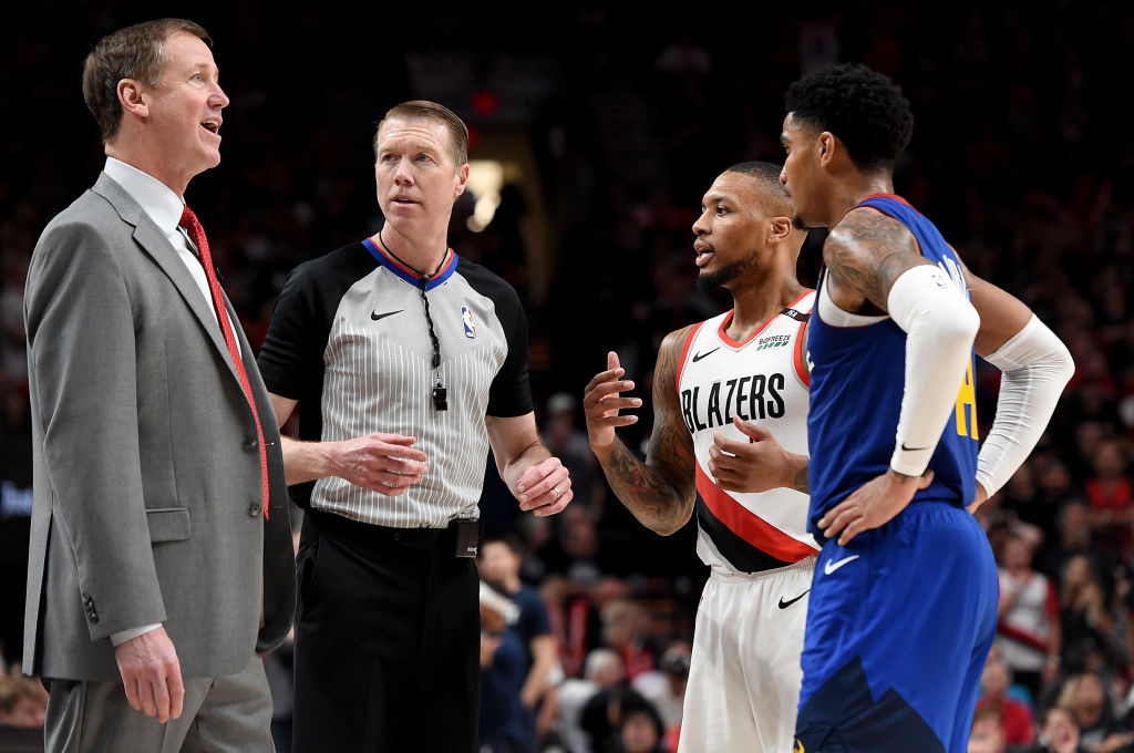 Portland Trail Blazers coach Terry Stotts (left) relies on Damian Lillard (second from right) when asking for a coach's challenge review.
