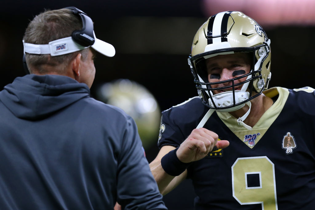 Drew Brees #9 of the New Orleans Saints and head coach Sean Payton