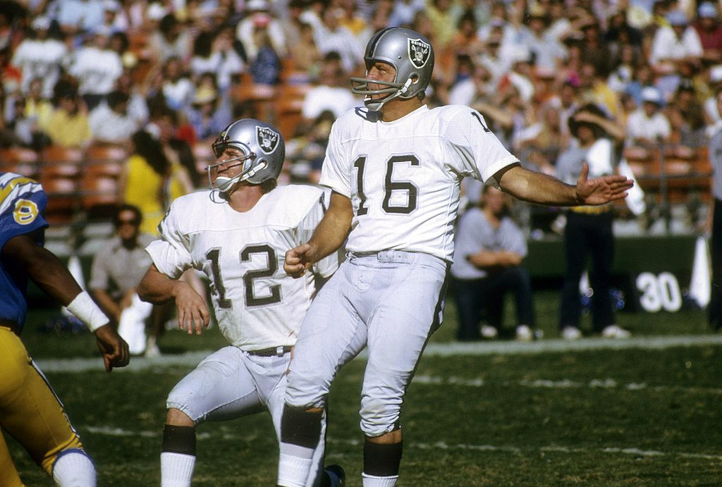 The oldest NFL player ever, George Blanda, attempting a field goal.