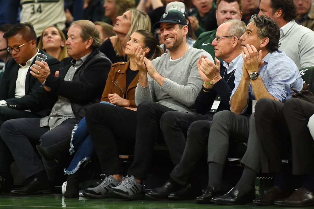 Green Bay Packers quarterback Aaron Rodgers and Danica Patrick attend Game Two of the first round of the 2019 NBA Eastern Conference Playoffs