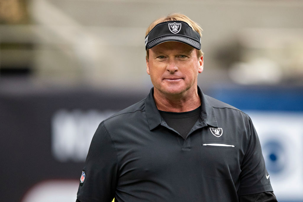 Head Coach Jon Gruden of the Oakland Raiders watches his team warm up