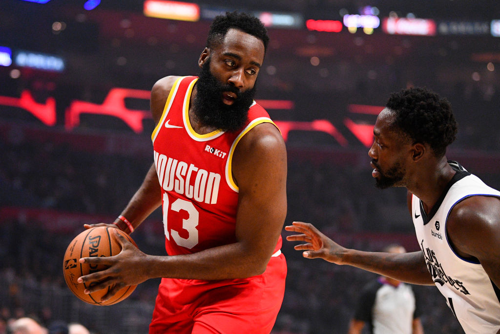 NBA player James Harden sizes up his defender