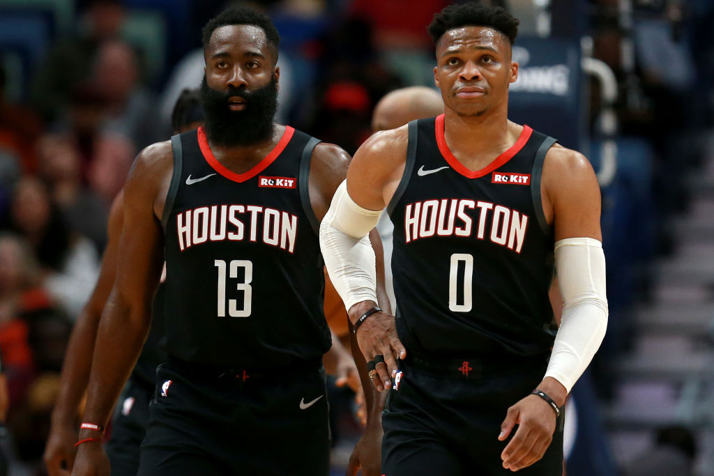 James Harden and Russell Westbrook walk down the floor together.