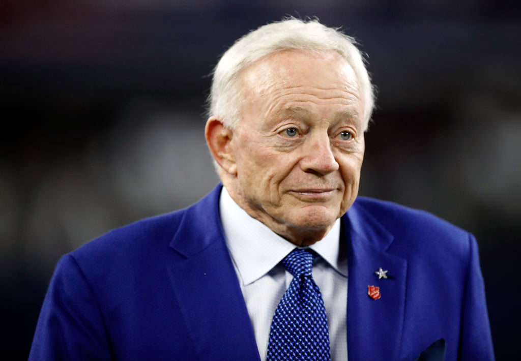 Jerry Jones walks on the field before the game.