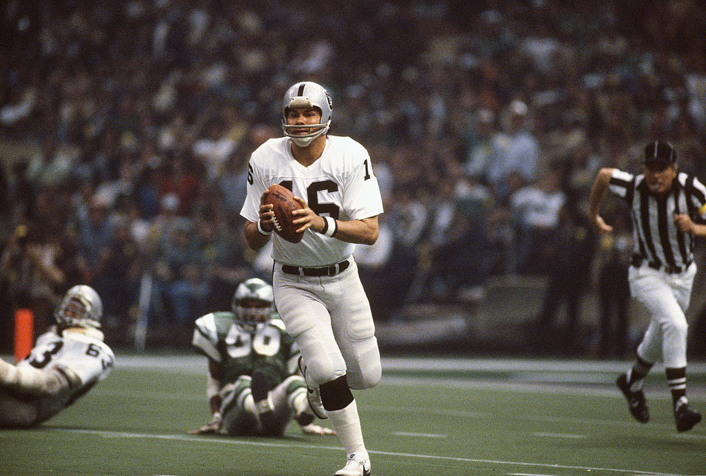 Jim Plunkett of the Oakland Raiders runs with the ball in 1981