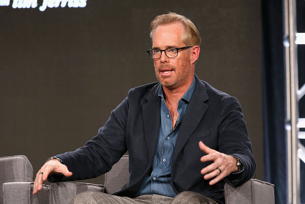Joe Buck talking on stage during a show.