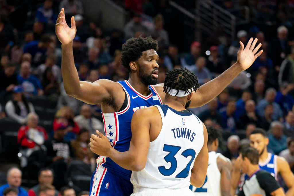 Joel Embiid and Karl Anthony-Towns get tangled up.