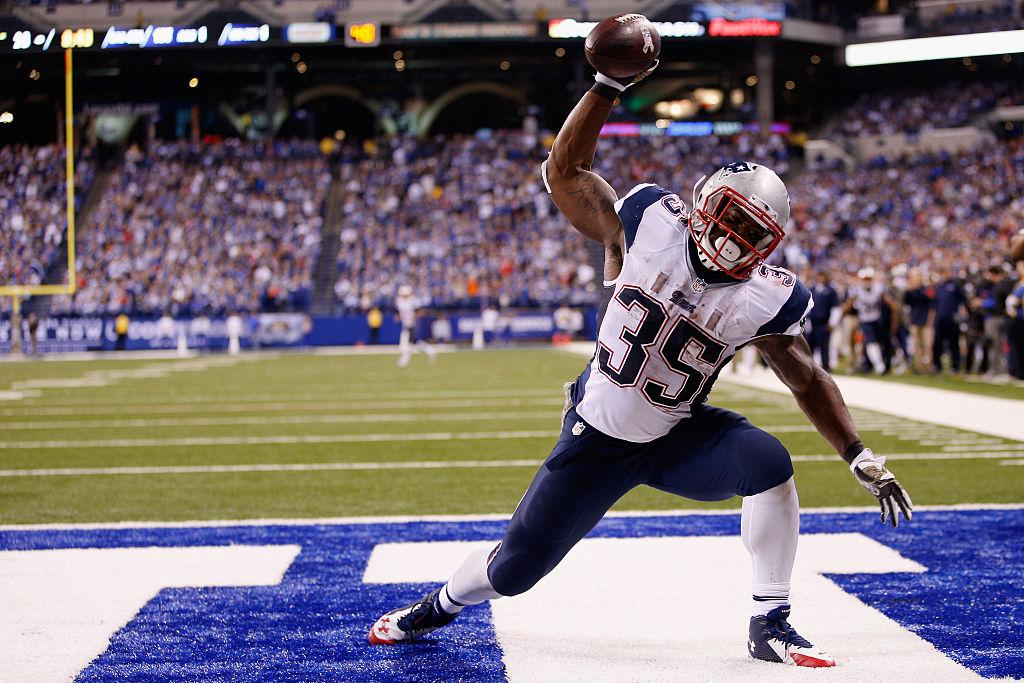 Jonas Gray spiking a football after scoring a touchdown.