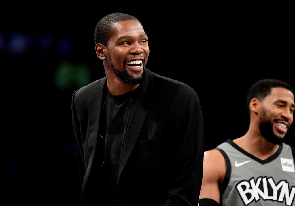 Kevin Durant of the Brooklyn Nets laughs during a game