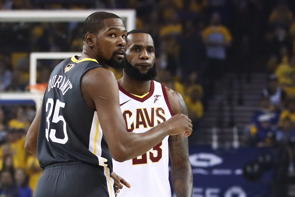 Kevin Durant of the Golden State Warriors and LeBron James of the Cleveland Cavaliers react in the 2018 NBA Finals