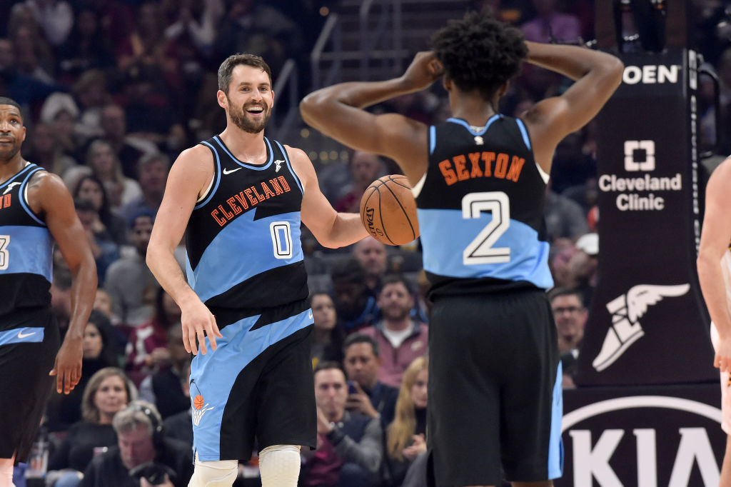 Kevin Love laughs with Collin Sexton of the Cleveland Cavaliers