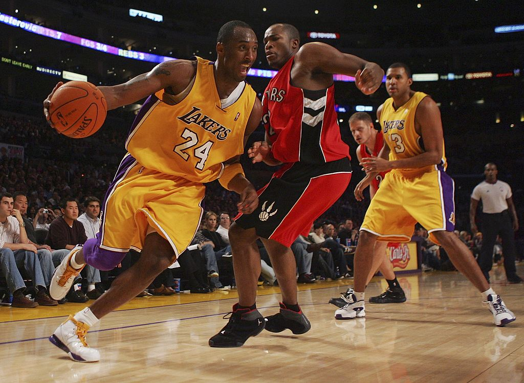 Kobe Bryant of the Los Angeles Lakers drives to the basket in 2002