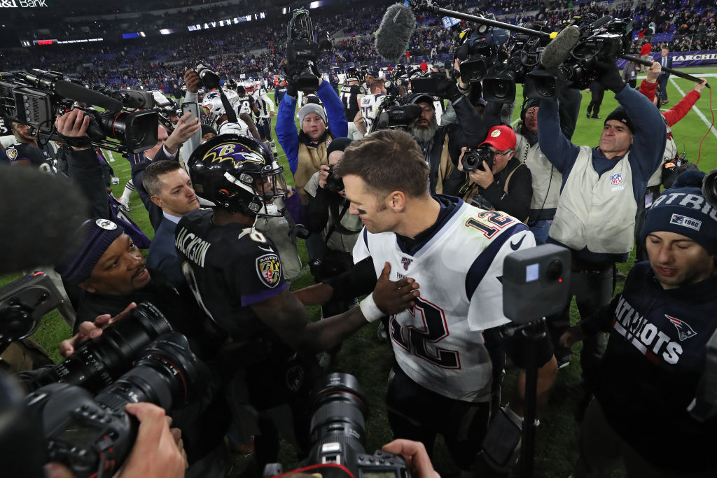 Lamar Jackson and Tom Brady exchange words after the game