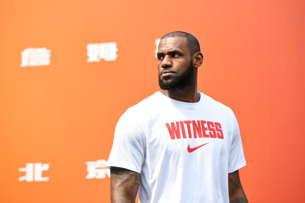 LeBron James wearing a Nike shirt at a press event.