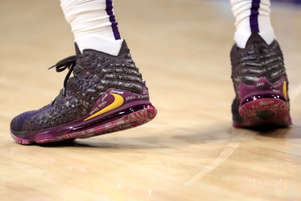 A close up of LeBron James' shoes during a game.