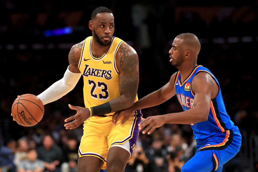 LeBron James sizes up his options with Chris Paul defending
